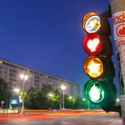 Traffic lights with red heart, amber star, green teardrop