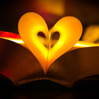 Pages of a book curved to form a warmly lit heart